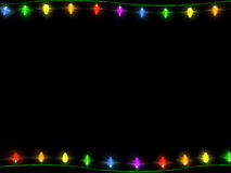Christmas Lights Border 1. A string of Christmas lights bordering the top and bottom on a black background Stock Photos