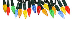 Christmas lights border. Multicolored string of Christmas lights isolated on white background Royalty Free Stock Photo