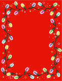 Christmas lights border or frame on red. Christmas lights vector vertical border or red framed background Royalty Free Stock Photo