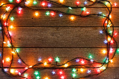 Christmas lights border on wood background stock images