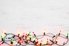 Christmas lights bulb decoration on white wood. royalty free stock image