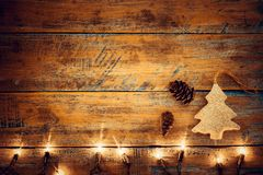 Christmas lights bulb with decoration on wood table. Merry christmas xmas background. topview, border design - rustic and vintage styles Royalty Free Stock Image