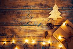 Christmas lights bulb with decoration on wood table. Merry christmas xmas background. topview, border design - rustic and vintage styles Royalty Free Stock Photography