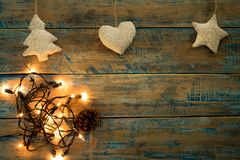 Christmas lights bulb with decoration on wood table. Merry christmas xmas background. topview, border design - rustic and vintage styles Royalty Free Stock Images