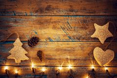 Christmas lights bulb with decoration on wood table. Merry christmas xmas background. topview, border design - rustic and vintage styles Stock Image