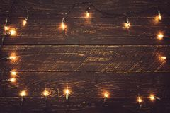 Christmas lights bulb on wood table. royalty free stock images