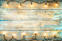 Christmas lights bulb on wood table. royalty free stock photo