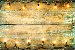 Christmas lights bulb on wood table. royalty free stock image