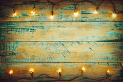 Christmas lights bulb on wood table. Merry christmas xmas background stock photos