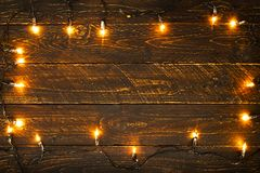 Christmas lights bulb on wood table. Merry christmas xmas background. topview, border design - rustic and vintage styles Stock Photography