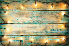 Christmas lights bulb on wood table. Merry christmas xmas background. topview, border design - rustic and vintage styles Stock Photo