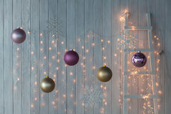 Christmas lights burning on a white wooden background. Stock Images