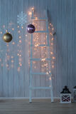 Christmas lights burning on a white wooden background. Xmas background royalty free stock photos