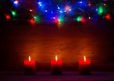 Christmas lights and candles Stock Image