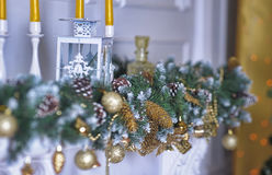 Christmas lights and candles. On the fireplace royalty free stock photo