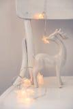 Christmas lights and ceramic deer Stock Image