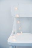 Christmas lights on chair Royalty Free Stock Photo