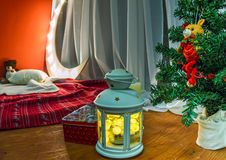 Christmas lights at the Christmas tree on a windowsill. With a blanket royalty free stock image