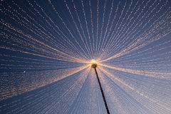 Christmas lights in the city. Image showing LED Christmas lights hanging from a pole in the center of the city Royalty Free Stock Photo