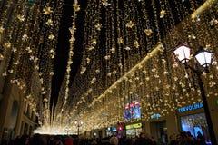 Christmas lights on city street. stock photos