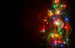 Christmas lights are a classic symbol. Christmas lights on a tree in different colors are classic symbol of Christmas stock images