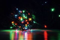 Christmas lights. Colorful out of focus Christmas tree lights blurred. Balls of bokeh light in the background Royalty Free Stock Images