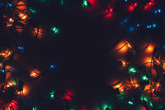 Christmas lights on dark background. Decorative garland. Tinted photo.  stock images