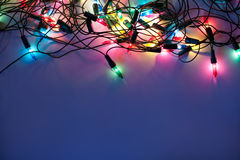 Christmas lights on dark blue background Royalty Free Stock Images