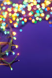 Christmas lights on dark blue background Royalty Free Stock Photo