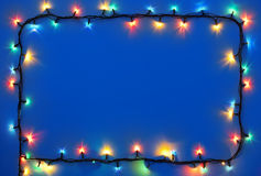 Christmas lights on dark blue background. With copy space. Decorative garland royalty free stock photos