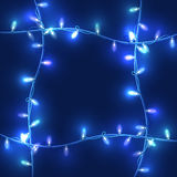 Christmas lights on dark blue background, bright lights Royalty Free Stock Photography