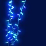 Christmas lights on dark blue background Stock Photo
