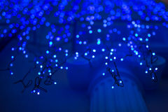 Christmas lights on dark blue background with copy space. Decorative garland Royalty Free Stock Photos