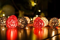 Christmas lights on dark wooden background with reflections. Christmas and New Year holidays royalty free stock photos