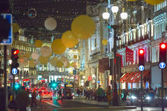 Free Christmas Lights Decoration At Regent Street And Lots Of People. London Royalty Free Stock Photo - 75703945