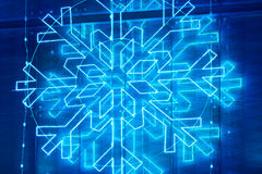 Christmas lights decoration on a building facade in blue tone Stock Photos