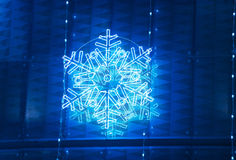 Christmas lights decoration on a building facade in blue tone Stock Images