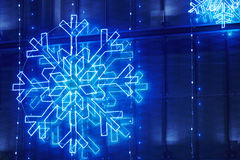 Christmas lights decoration on a building facade in blue tone Royalty Free Stock Images