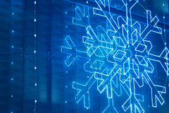 Christmas lights decoration on a building facade in blue tone Stock Image