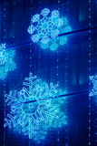 Christmas lights decoration on a building facade in blue tone Royalty Free Stock Photography