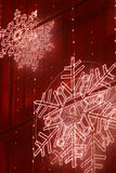 Christmas lights decoration on a building facade in red tone Royalty Free Stock Photo