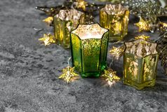 Christmas lights decoration Candles golden stars. Christmas lights decoration. Candles and golden stars on dark background stars Stock Photography