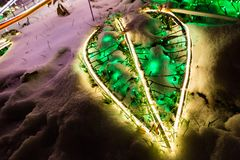 Christmas lights  decoration on snow illumination in winter night holidays. Christmas lights decoration on snow illumination at winter night holidays. New Year Stock Image