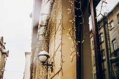 Christmas lights decoration in snowy city streets. european city. Preparing for winter christmas holidays, space for text. beautiful outdoor illumination royalty free stock photography