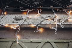 Christmas lights decoration on window in snowy city streets. eu. Ropean city preparing for winter christmas holidays, space for text. beautiful outdoor stock photos