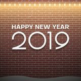 Christmas lights decorations on brown brick wall background. New Year 2019 concept royalty free illustration