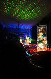 Christmas lights decorations. In dark interior on Christmas eve with strobe lights and dark background with copy space stock images
