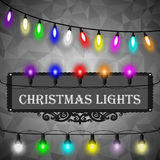 Christmas lights decorations set on black abstract geometric rumpled triangular graphic background. Vector Royalty Free Stock Photos