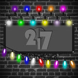 Christmas lights decorations set on black brick wall background Stock Photos