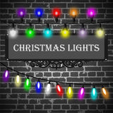 Christmas lights decorations set on black brick wall background Royalty Free Stock Photo